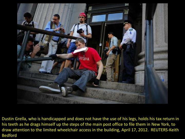 Dustin Grella, who is handicapped and does not have the use of his legs, holds his tax return in his...