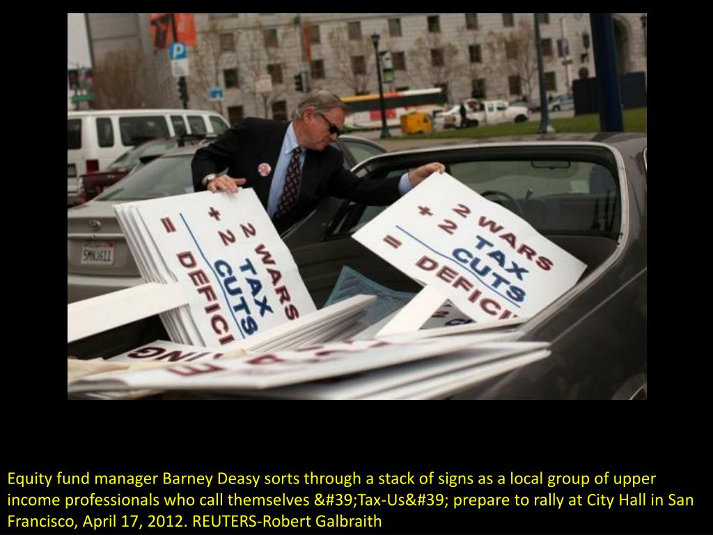 Equity fund manager Barney Deasy sorts through a stack of signs as a local group of upper income professionals who call themselves 'Tax-Us' prepare to rally at City Hall in San Francisco, April 17, 2012. REUTERS-Robert Galbraith