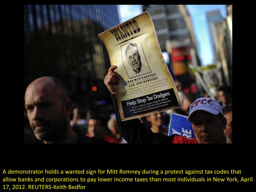 A demonstrator holds a wanted sign for Mitt Romney during a protest against tax codes that allow banks and corporations to pay lower income taxes than most individuals in New York, April 17, 2012. REUTERS-Keith Bedfor