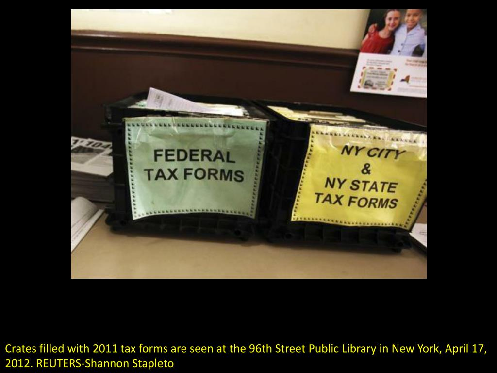 Crates filled with 2011 tax forms are seen at the 96th Street Public Library in New York, April 17, 2012. REUTERS-Shannon Stapleto
