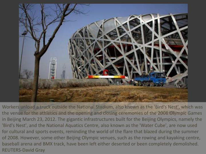 Workers unload a truck outside the National Stadium, also known as the 'Bird's Nest', which was the ...