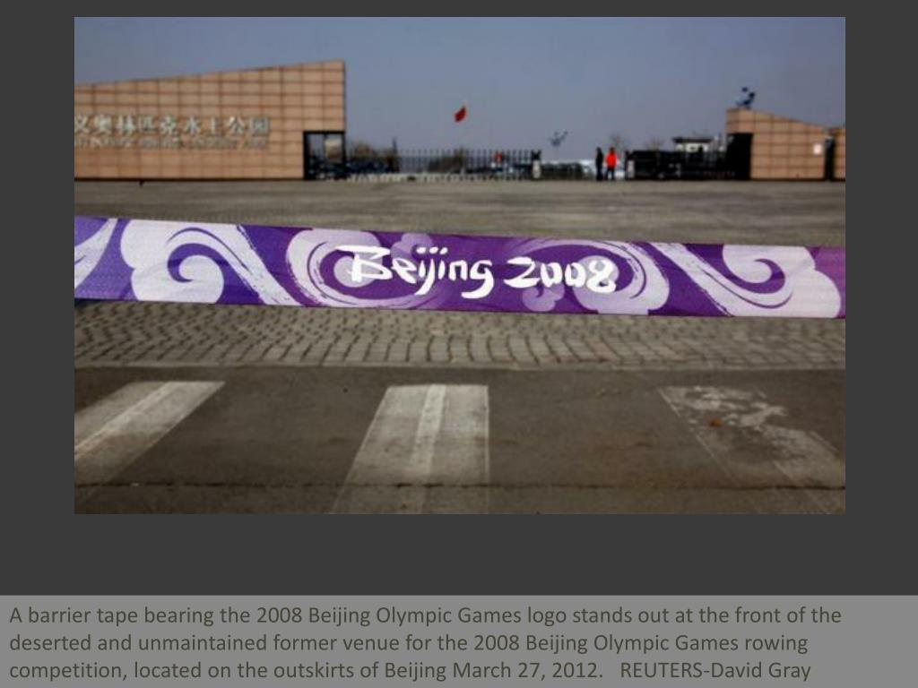 A barrier tape bearing the 2008 Beijing Olympic Games logo stands out at the front of the deserted and unmaintained former venue for the 2008 Beijing Olympic Games rowing competition, located on the outskirts of Beijing March 27, 2012.   REUTERS-David Gray