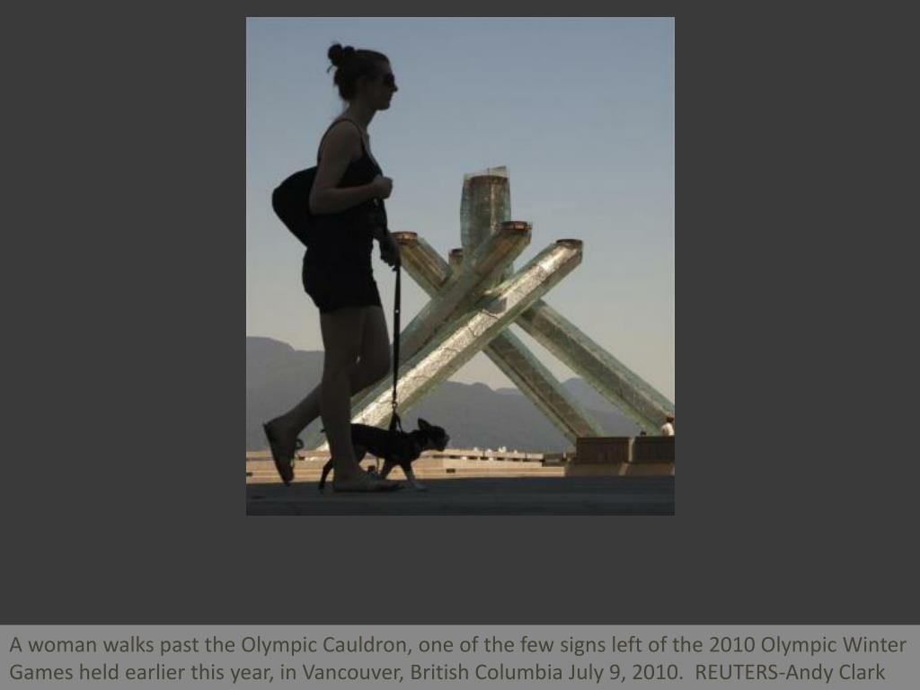 A woman walks past the Olympic Cauldron, one of the few signs left of the 2010 Olympic Winter Games held earlier this year, in Vancouver, British Columbia July 9, 2010.  REUTERS-Andy Clark