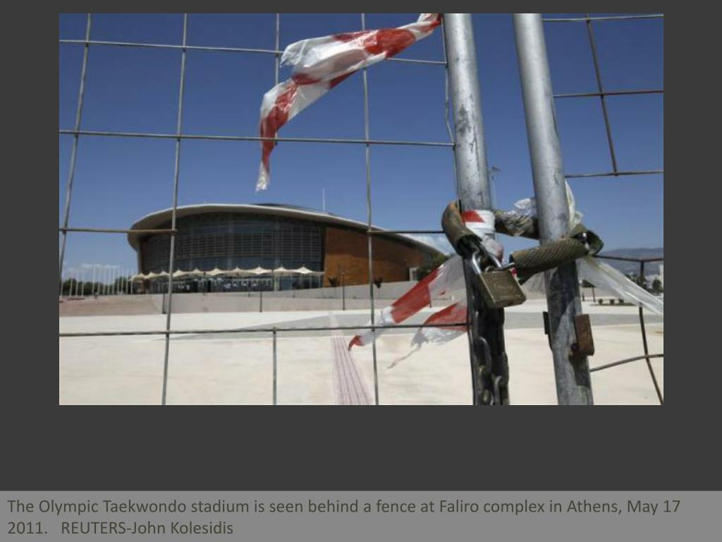 The Olympic Taekwondo stadium is seen behind a fence at Faliro complex in Athens, May 17 2011.   REUTERS-John Kolesidis