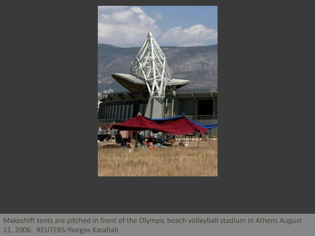 Makeshift tents are pitched in front of the Olympic beach volleyball stadium in Athens August 11, 2006.  REUTERS-Yiorgos Karahali