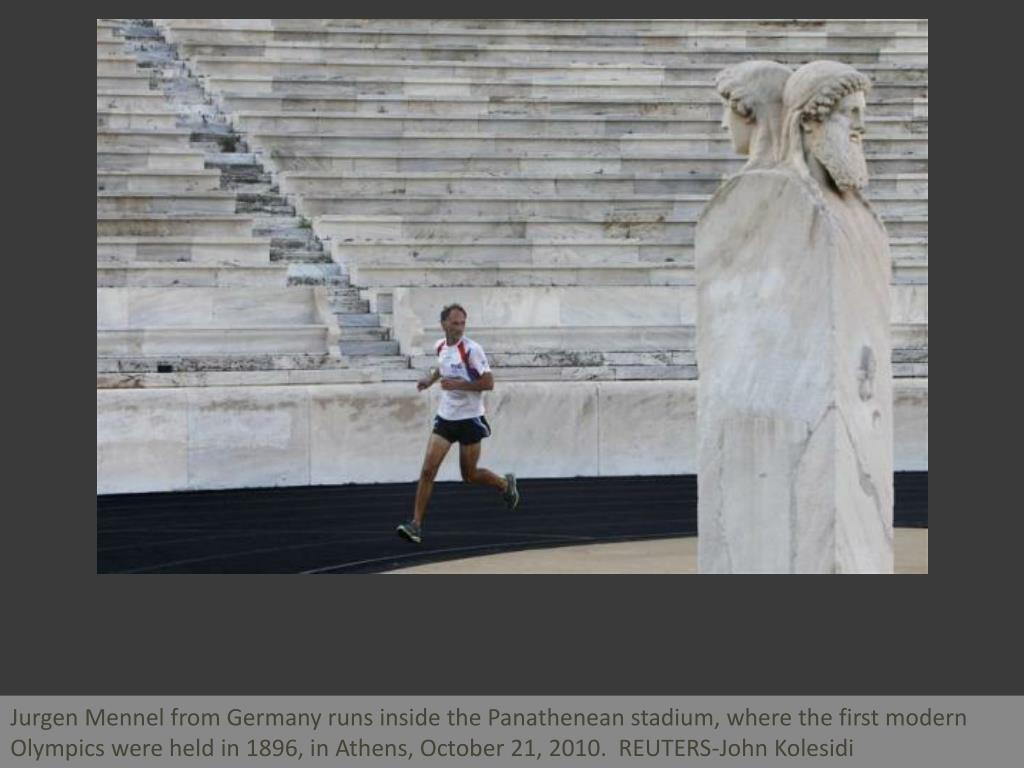 Jurgen Mennel from Germany runs inside the Panathenean stadium, where the first modern Olympics were held in 1896, in Athens, October 21, 2010.  REUTERS-John Kolesidi