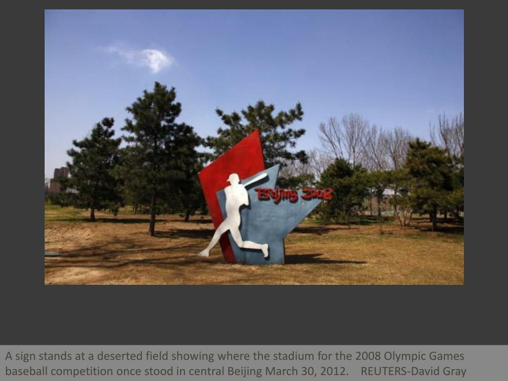 A sign stands at a deserted field showing where the stadium for the 2008 Olympic Games baseball competition once stood in central Beijing March 30, 2012.    REUTERS-David Gray
