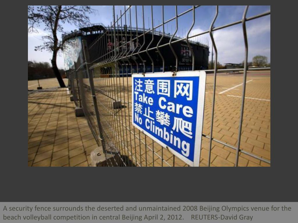 A security fence surrounds the deserted and unmaintained 2008 Beijing Olympics venue for the beach volleyball competition in central Beijing April 2, 2012.    REUTERS-David Gray