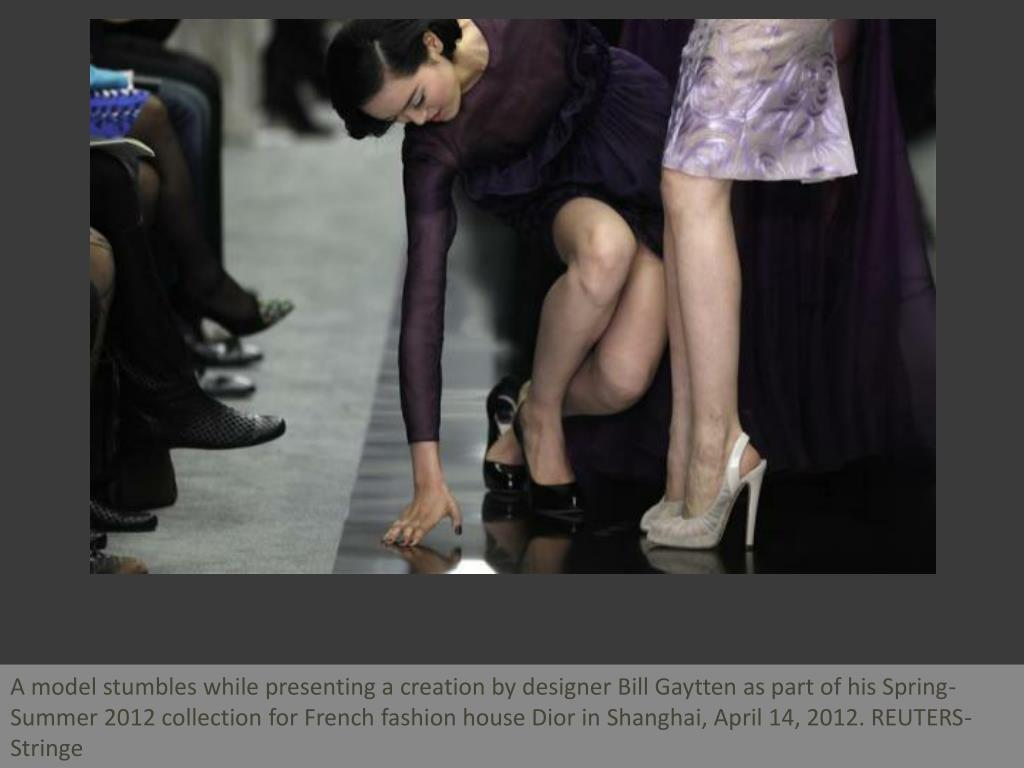 A model stumbles while presenting a creation by designer Bill Gaytten as part of his Spring-Summer 2012 collection for French fashion house Dior in Shanghai, April 14, 2012. REUTERS-Stringe