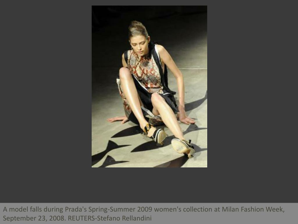 A model falls during Prada's Spring-Summer 2009 women's collection at Milan Fashion Week, September 23, 2008. REUTERS-Stefano Rellandini