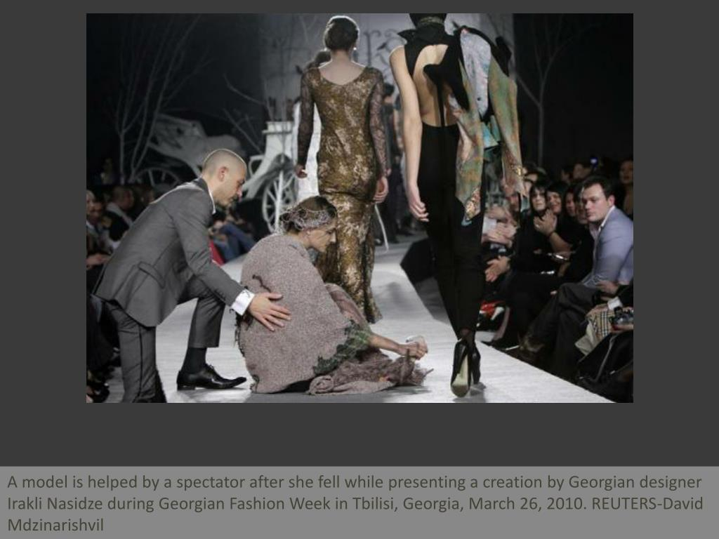 A model is helped by a spectator after she fell while presenting a creation by Georgian designer Irakli Nasidze during Georgian Fashion Week in Tbilisi, Georgia, March 26, 2010. REUTERS-David Mdzinarishvil