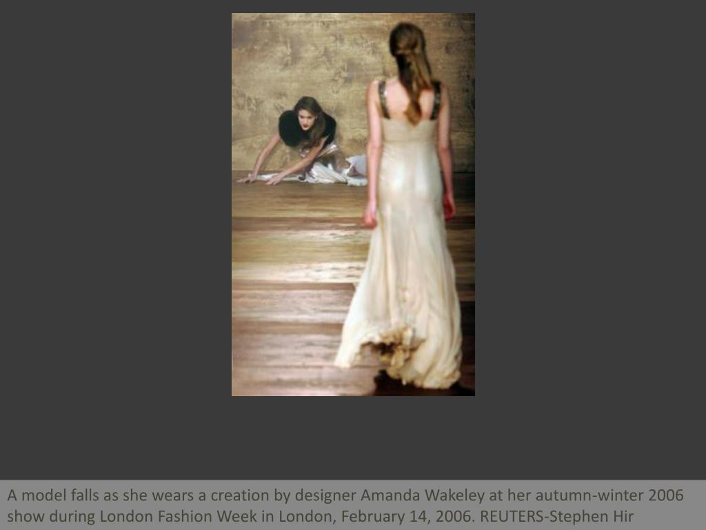 A model falls as she wears a creation by designer Amanda Wakeley at her autumn-winter 2006 show during London Fashion Week in London, February 14, 2006. REUTERS-Stephen Hir