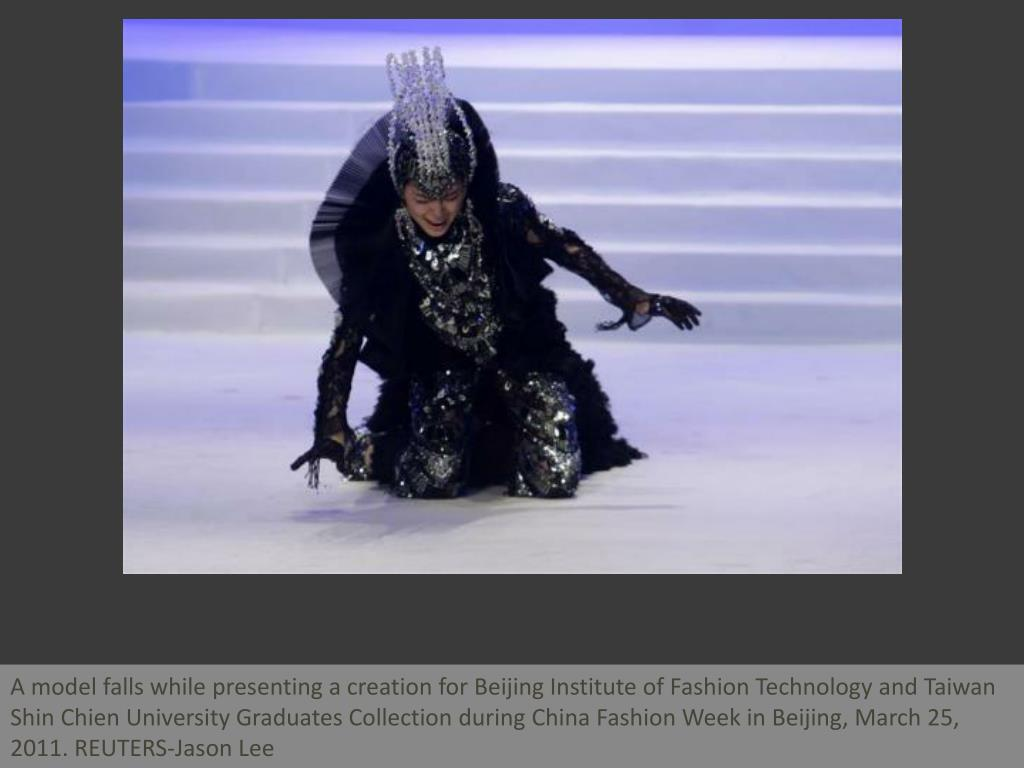 A model falls while presenting a creation for Beijing Institute of Fashion Technology and Taiwan Shin Chien University Graduates Collection during China Fashion Week in Beijing, March 25, 2011. REUTERS-Jason Lee