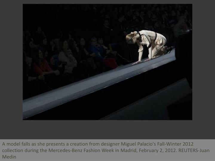 A model falls as she presents a creation from designer Miguel Palacio's Fall-Winter 2012 collection ...