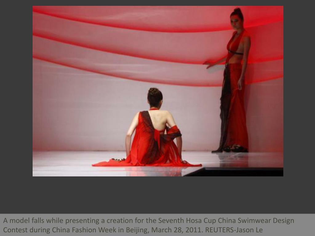 A model falls while presenting a creation for the Seventh Hosa Cup China Swimwear Design Contest during China Fashion Week in Beijing, March 28, 2011. REUTERS-Jason Le