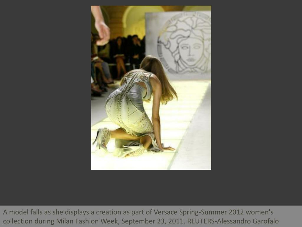 A model falls as she displays a creation as part of Versace Spring-Summer 2012 women's collection during Milan Fashion Week, September 23, 2011. REUTERS-Alessandro Garofalo