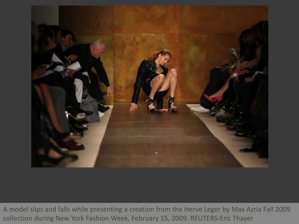 A model slips and falls while presenting a creation from the Herve Leger by Max Azria Fall 2009 collection during New York Fashion Week, February 15, 2009. REUTERS-Eric Thayer