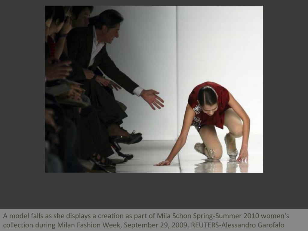 A model falls as she displays a creation as part of Mila Schon Spring-Summer 2010 women's collection during Milan Fashion Week, September 29, 2009. REUTERS-Alessandro Garofalo