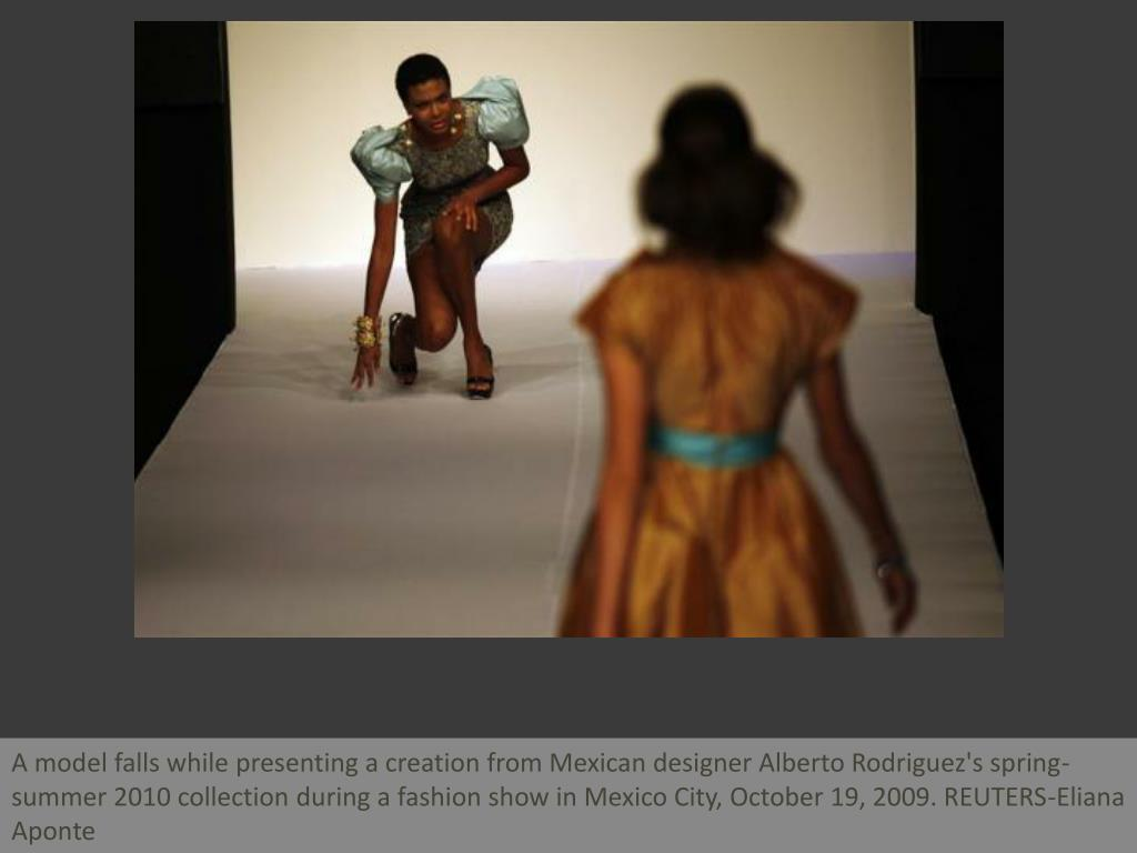 A model falls while presenting a creation from Mexican designer Alberto Rodriguez's spring-summer 2010 collection during a fashion show in Mexico City, October 19, 2009. REUTERS-Eliana Aponte