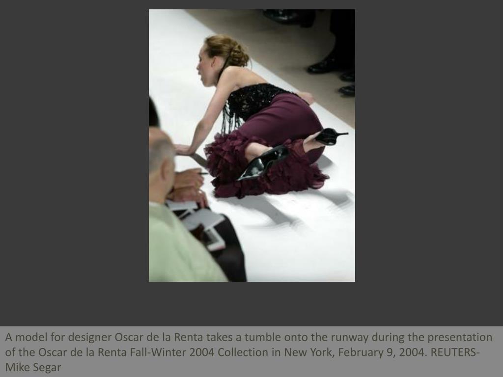 A model for designer Oscar de la Renta takes a tumble onto the runway during the presentation of the Oscar de la Renta Fall-Winter 2004 Collection in New York, February 9, 2004. REUTERS-Mike Segar