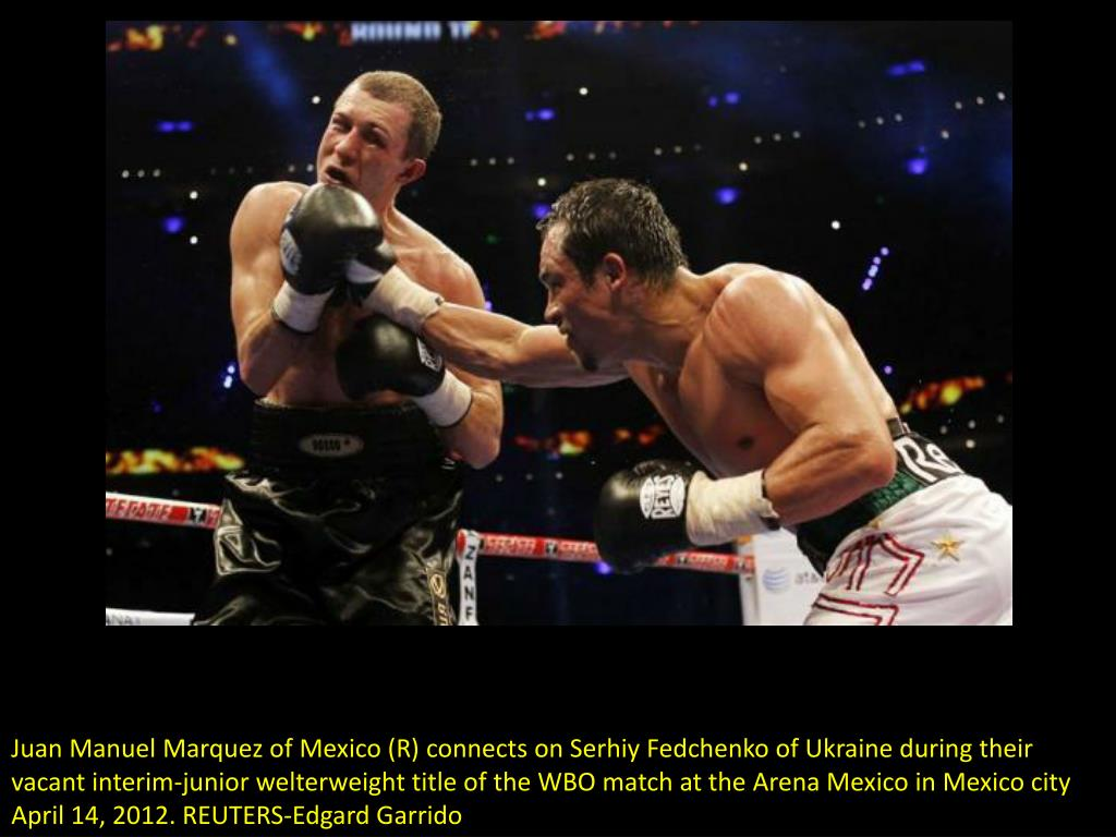 Juan Manuel Marquez of Mexico (R) connects on Serhiy Fedchenko of Ukraine during their vacant interim-junior welterweight title of the WBO match at the Arena Mexico in Mexico city April 14, 2012. REUTERS-Edgard Garrido