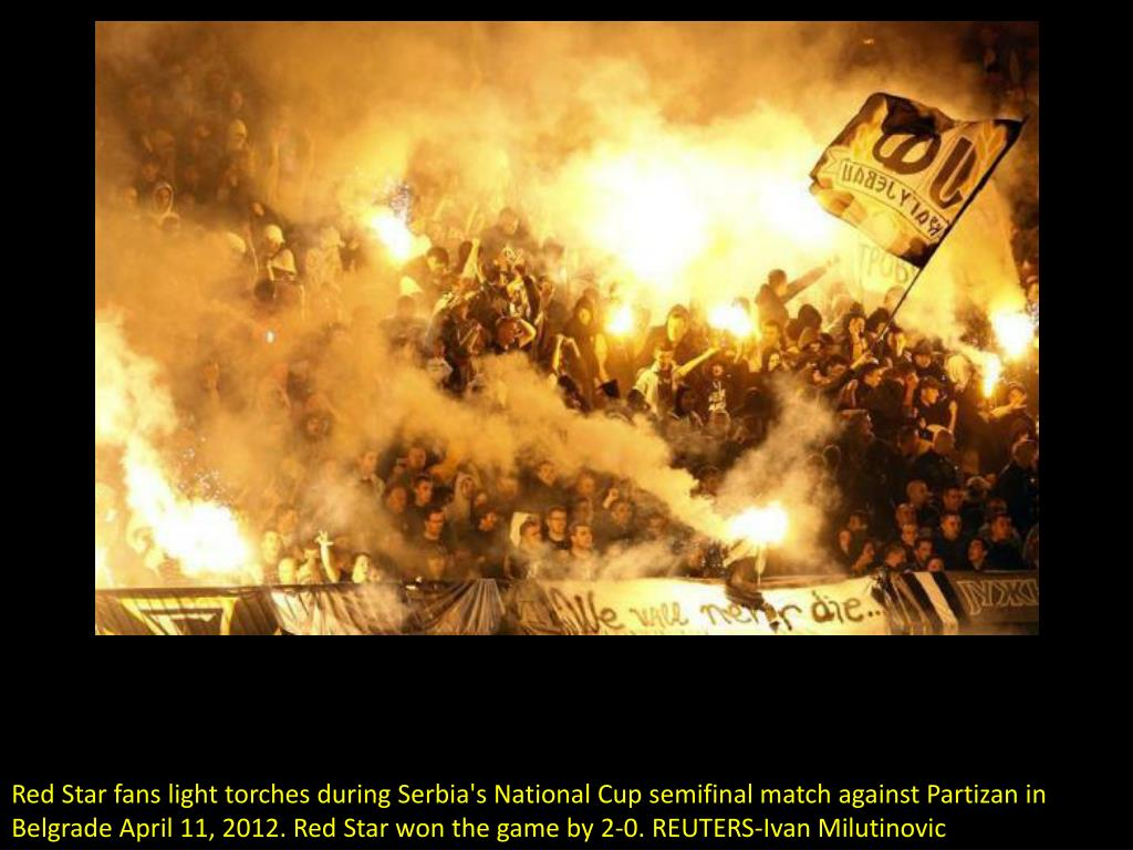 Red Star fans light torches during Serbia's National Cup semifinal match against Partizan in Belgrade April 11, 2012. Red Star won the game by 2-0. REUTERS-Ivan Milutinovic
