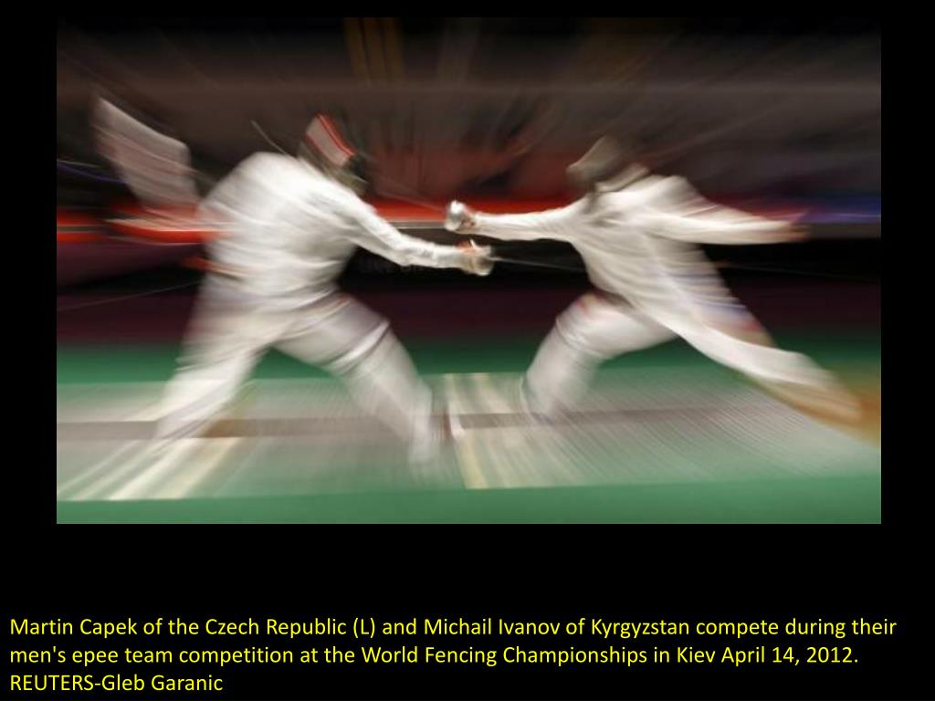 Martin Capek of the Czech Republic (L) and Michail Ivanov of Kyrgyzstan compete during their men's epee team competition at the World Fencing Championships in Kiev April 14, 2012.  REUTERS-Gleb Garanic