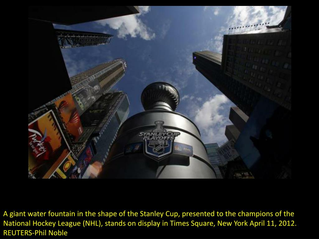 A giant water fountain in the shape of the Stanley Cup, presented to the champions of the National Hockey League (NHL), stands on display in Times Square, New York April 11, 2012. REUTERS-Phil Noble