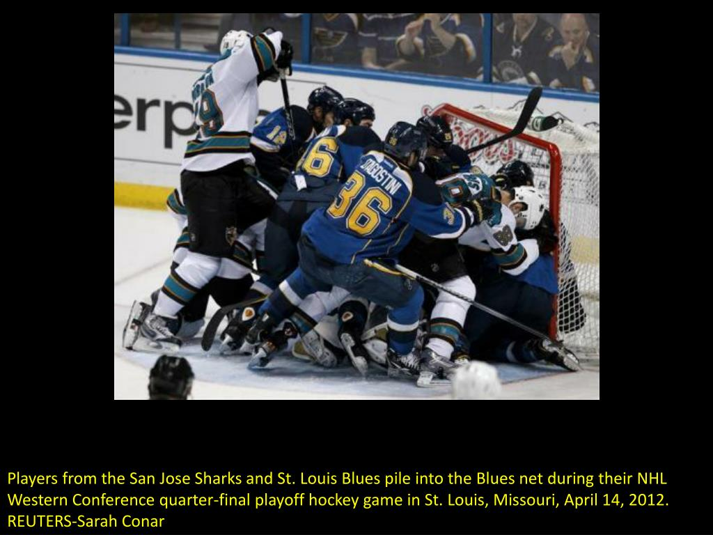 Players from the San Jose Sharks and St. Louis Blues pile into the Blues net during their NHL Western Conference quarter-final playoff hockey game in St. Louis, Missouri, April 14, 2012. REUTERS-Sarah Conar
