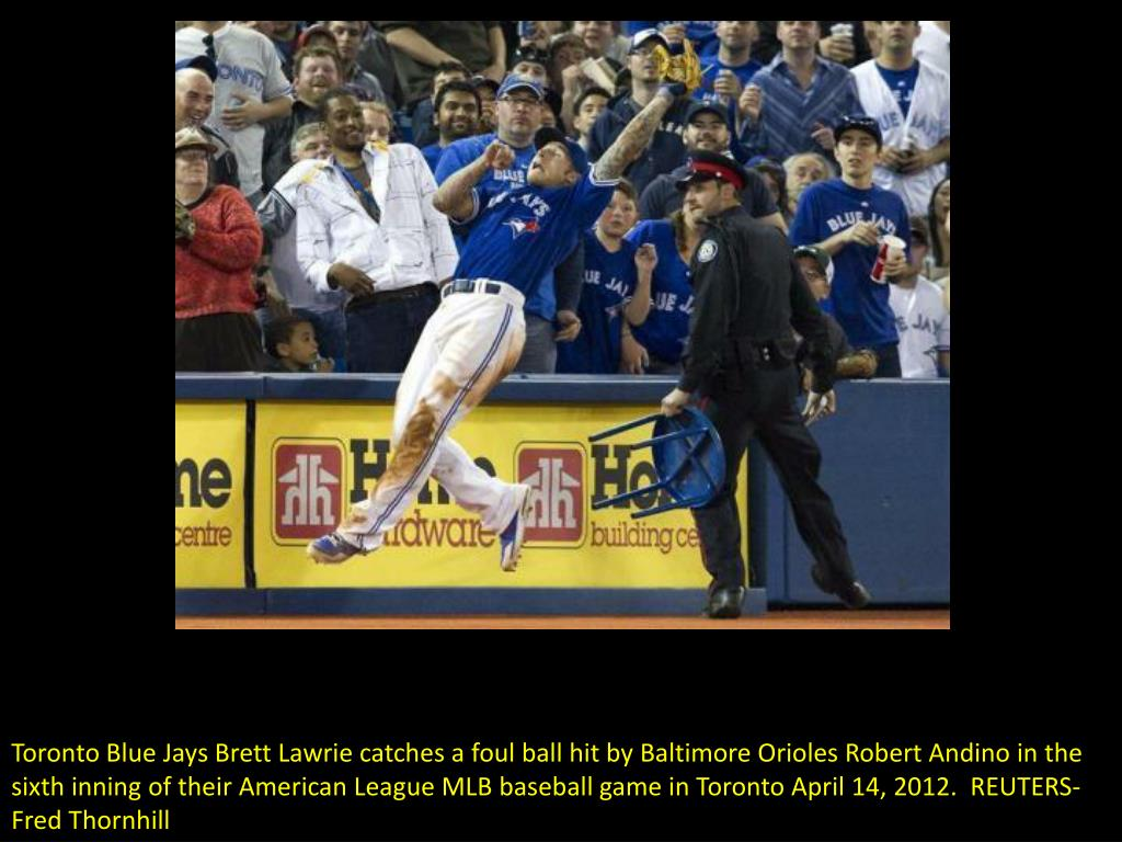 Toronto Blue Jays Brett Lawrie catches a foul ball hit by Baltimore Orioles Robert Andino in the sixth inning of their American League MLB baseball game in Toronto April 14, 2012.  REUTERS-Fred Thornhill