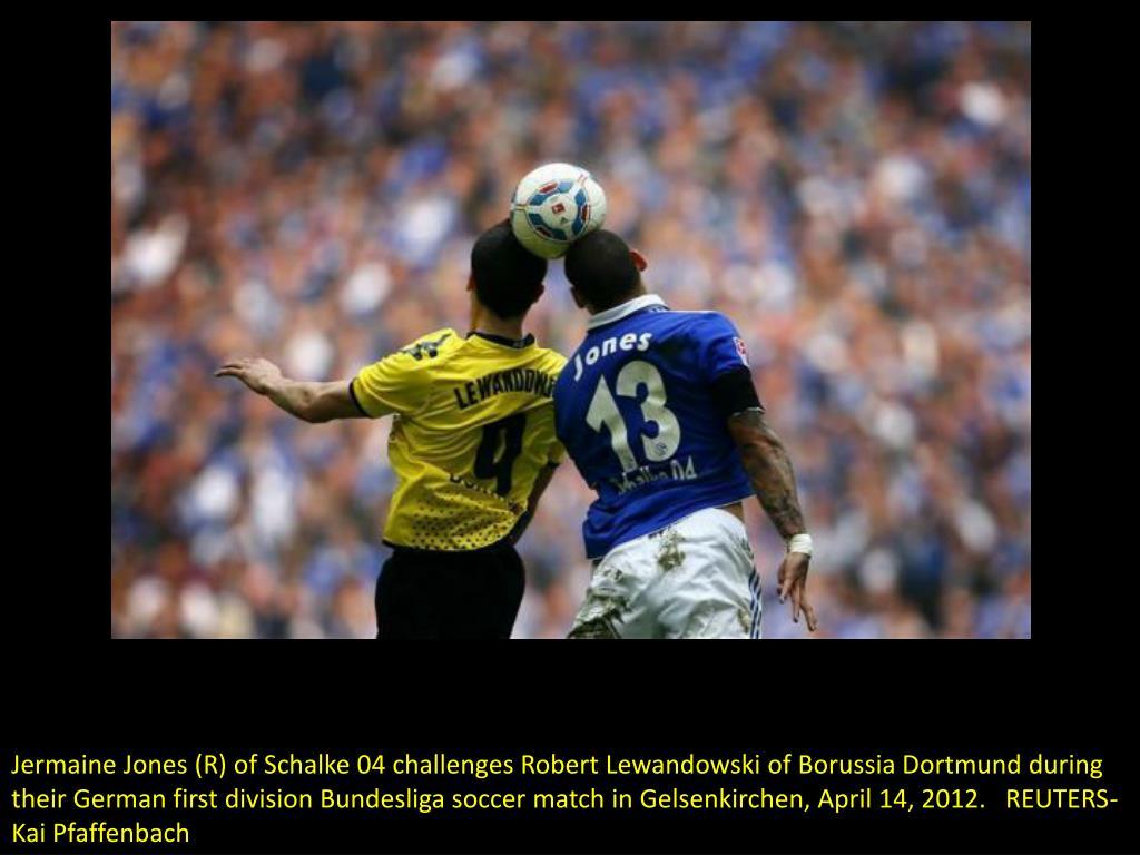 Jermaine Jones (R) of Schalke 04 challenges Robert Lewandowski of Borussia Dortmund during their German first division Bundesliga soccer match in Gelsenkirchen, April 14, 2012.   REUTERS-Kai Pfaffenbach