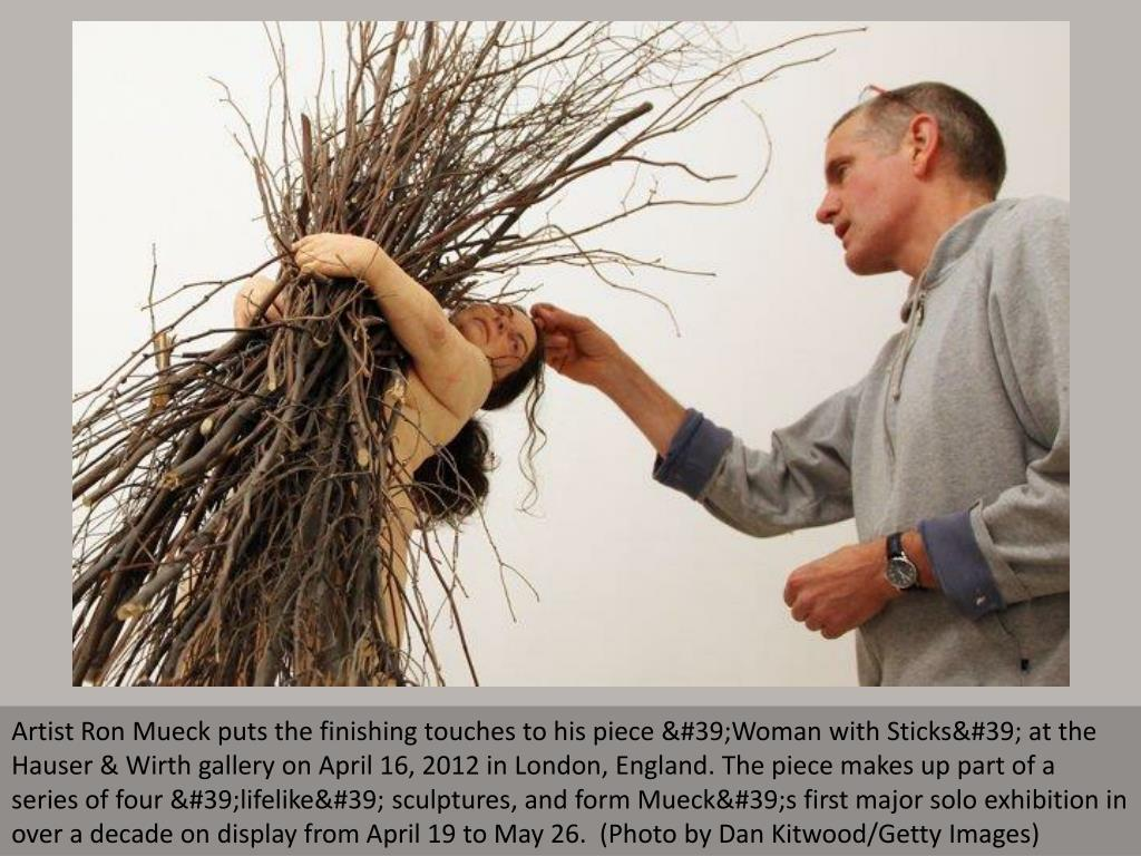 Artist Ron Mueck puts the finishing touches to his piece 'Woman with Sticks' at the Hauser & Wirth gallery on April 16, 2012 in London, England. The piece makes up part of a series of four 'lifelike' sculptures, and form Mueck's first major solo exhibition in over a decade on display from April 19 to May 26.  (Photo by Dan Kitwood/Getty Images)