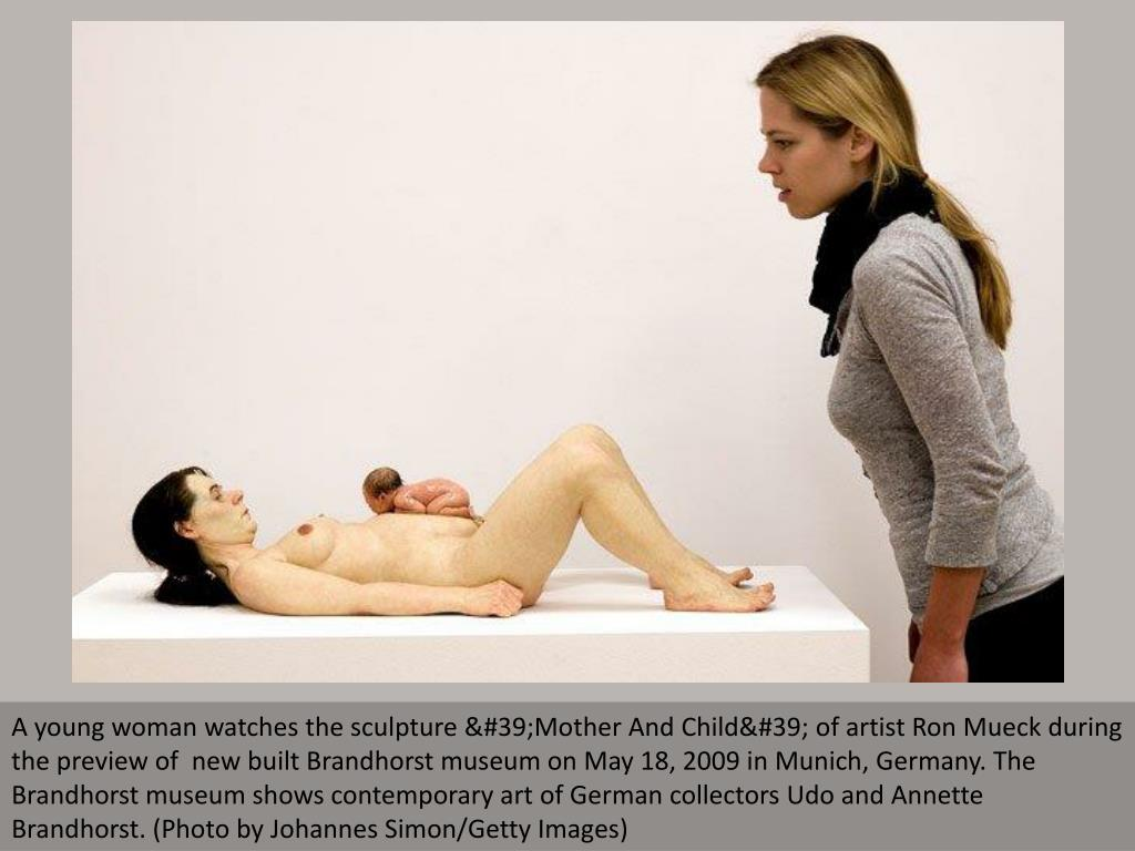 A young woman watches the sculpture 'Mother And Child' of artist Ron Mueck during the preview of  new built Brandhorst museum on May 18, 2009 in Munich, Germany. The Brandhorst museum shows contemporary art of German collectors Udo and Annette Brandhorst. (Photo by Johannes Simon/Getty Images)
