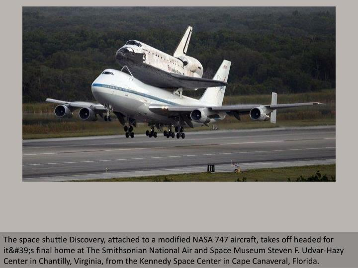 The space shuttle Discovery, attached to a modified NASA 747 aircraft, takes off headed for it's...