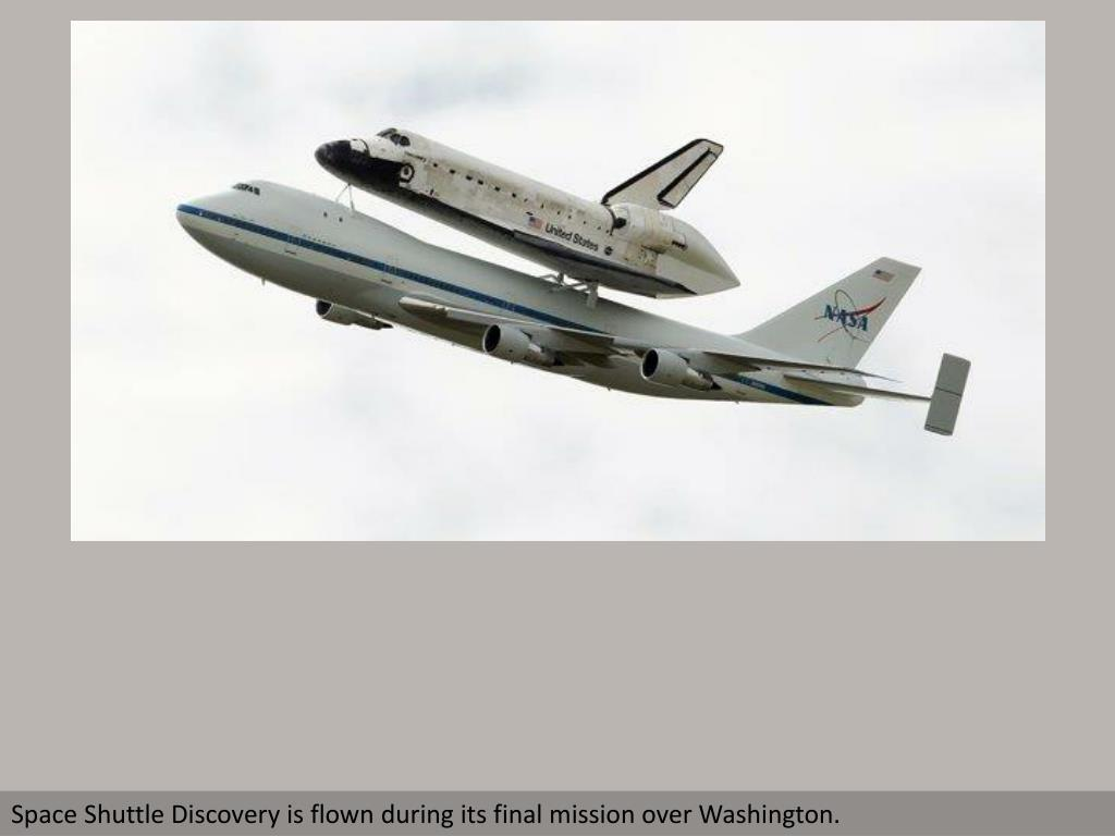 Space Shuttle Discovery is flown during its final mission over Washington.