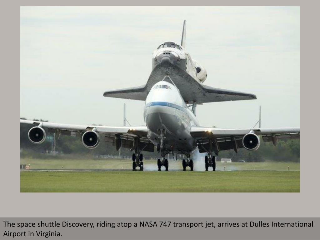 The space shuttle Discovery, riding atop a NASA 747 transport jet, arrives at Dulles International Airport in Virginia.