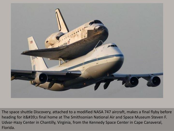 The space shuttle Discovery, attached to a modified NASA 747 aircraft, makes a final flyby before he...