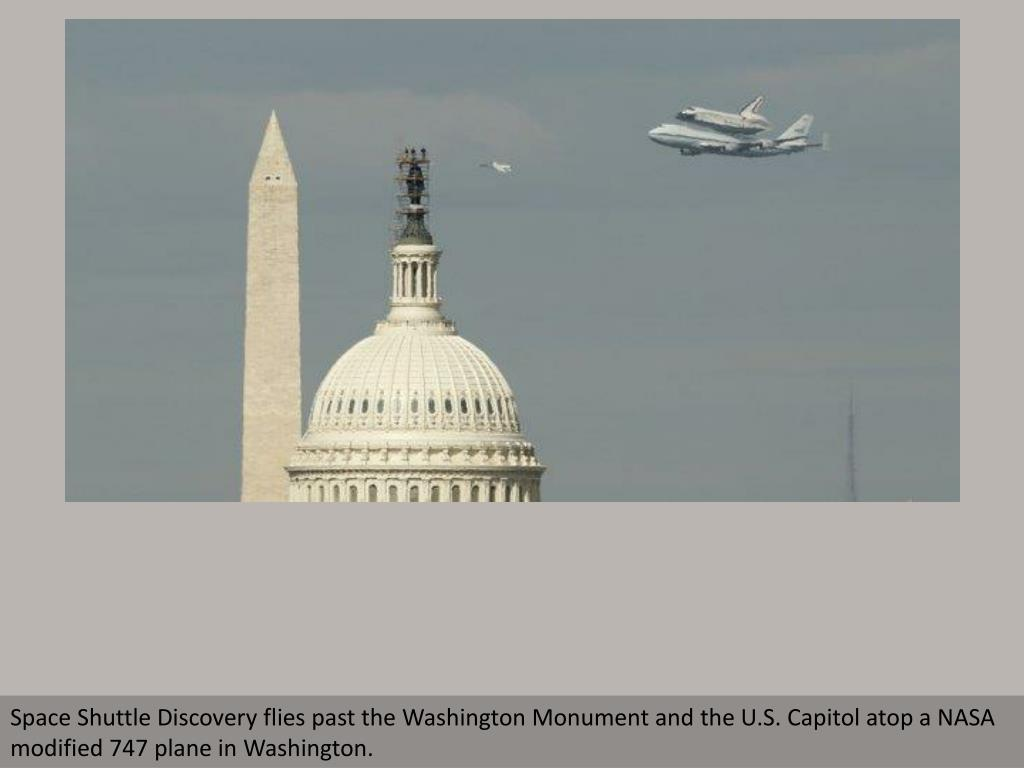 Space Shuttle Discovery flies past the Washington Monument and the U.S. Capitol atop a NASA modified 747 plane in Washington.