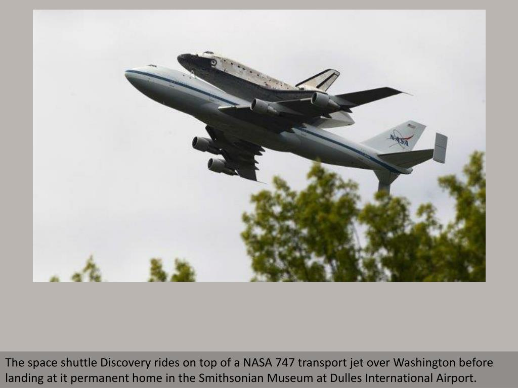 The space shuttle Discovery rides on top of a NASA 747 transport jet over Washington before landing at it permanent home in the Smithsonian Museum at Dulles International Airport.