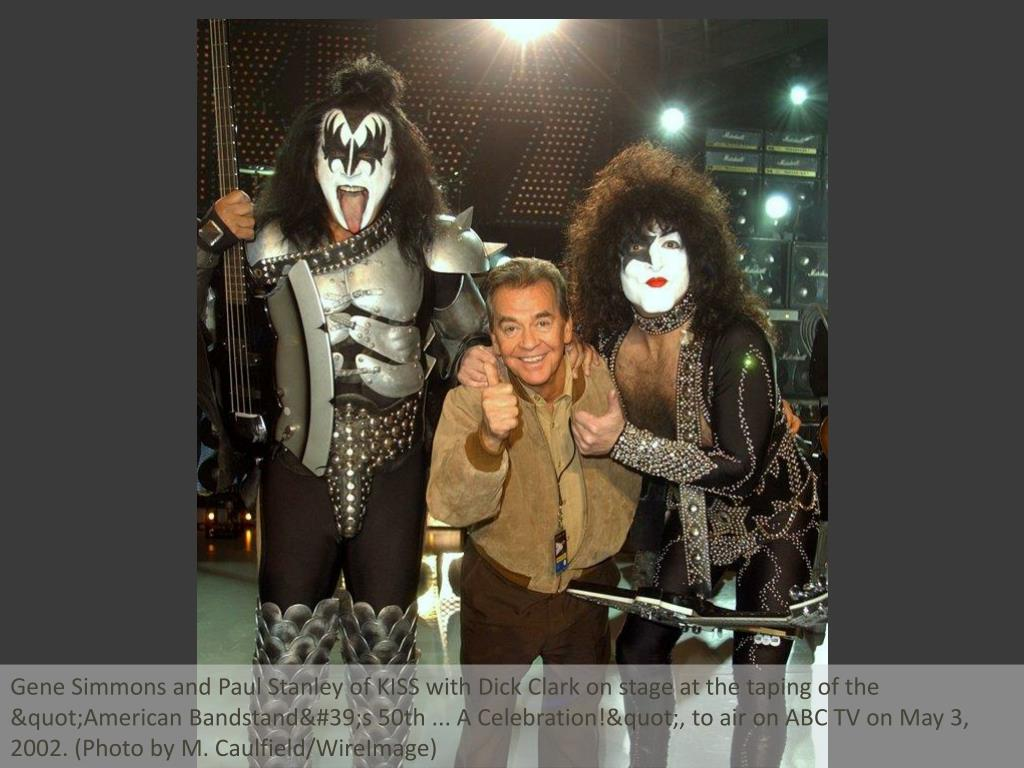 "Gene Simmons and Paul Stanley of KISS with Dick Clark on stage at the taping of the ""American Bandstand's 50th ... A Celebration!"", to air on ABC TV on May 3, 2002. (Photo by M. Caulfield/WireImage)"
