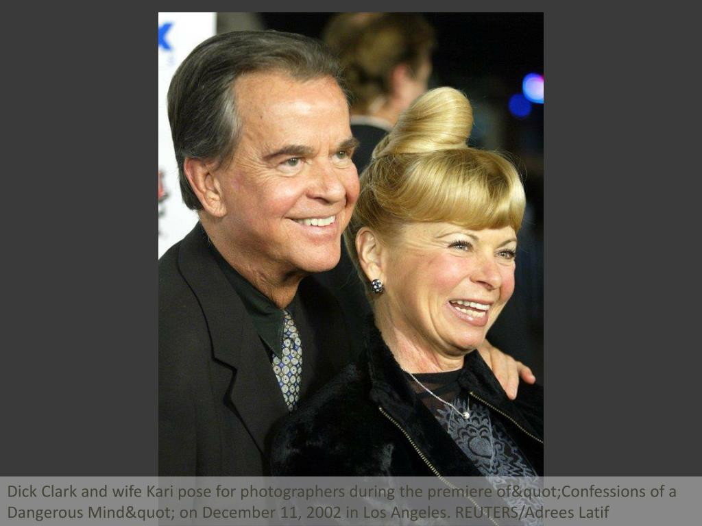 "Dick Clark and wife Kari pose for photographers during the premiere of""Confessions of a Dangerous Mind"" on December 11, 2002 in Los Angeles. REUTERS/Adrees Latif"