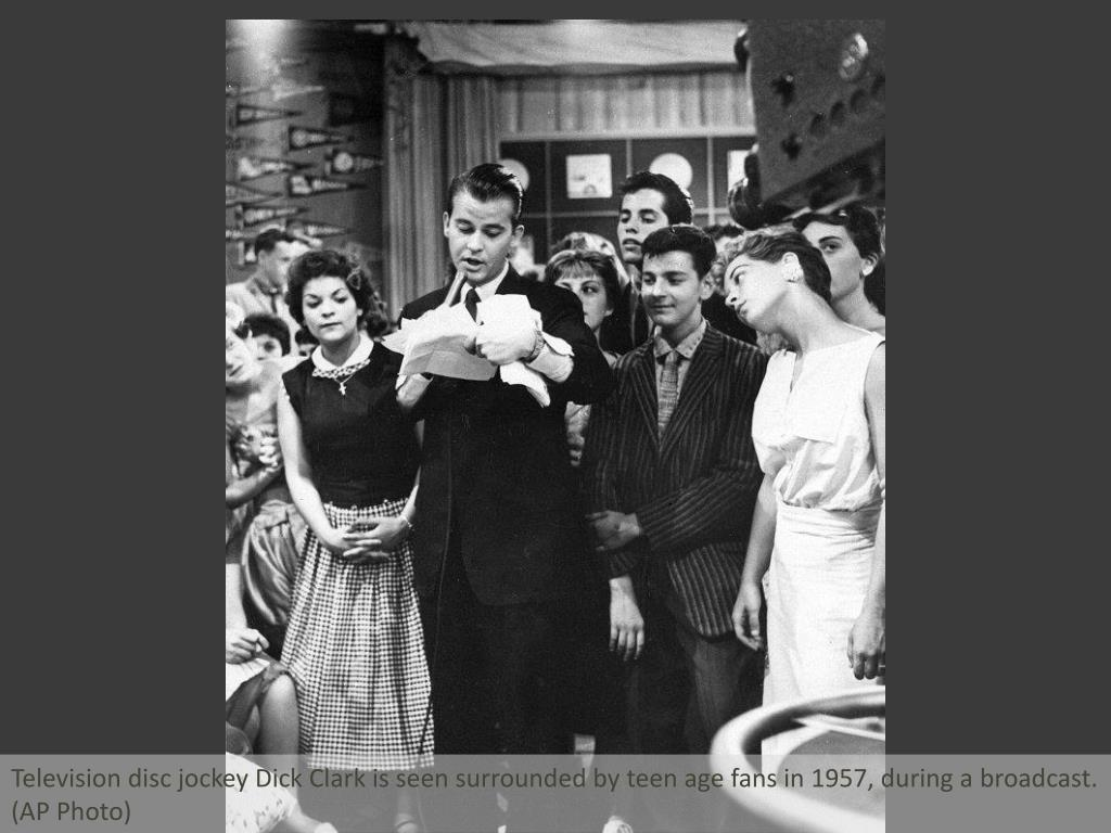 Television disc jockey Dick Clark is seen surrounded by teen age fans in 1957, during a broadcast.  (AP Photo)