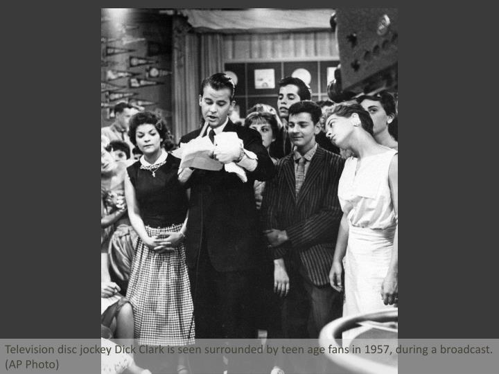 Television disc jockey Dick Clark is seen surrounded by teen age fans in 1957, during a broadcast.  ...