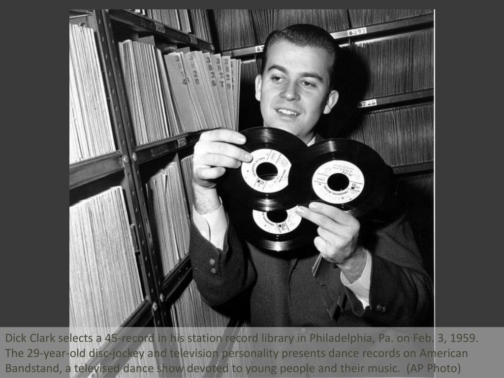 Dick Clark selects a 45-record in his station record library in Philadelphia, Pa. on Feb. 3, 1959. The 29-year-old disc-jockey and television personality presents dance records on American Bandstand, a televised dance show devoted to young people and their music.  (AP Photo)