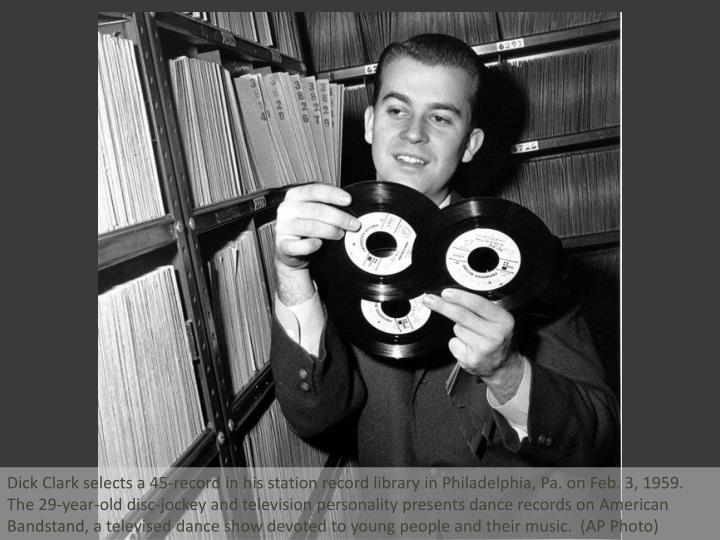 Dick Clark selects a 45-record in his station record library in Philadelphia, Pa. on Feb. 3, 1959. T...