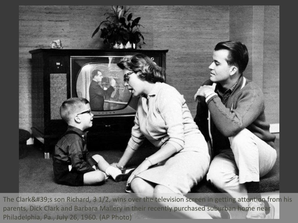 The Clark's son Richard, 3 1/2, wins over the television screen in getting attention from his parents, Dick Clark and Barbara Mallery in their recently purchased suburban home near Philadelphia, Pa., July 26, 1960. (AP Photo)