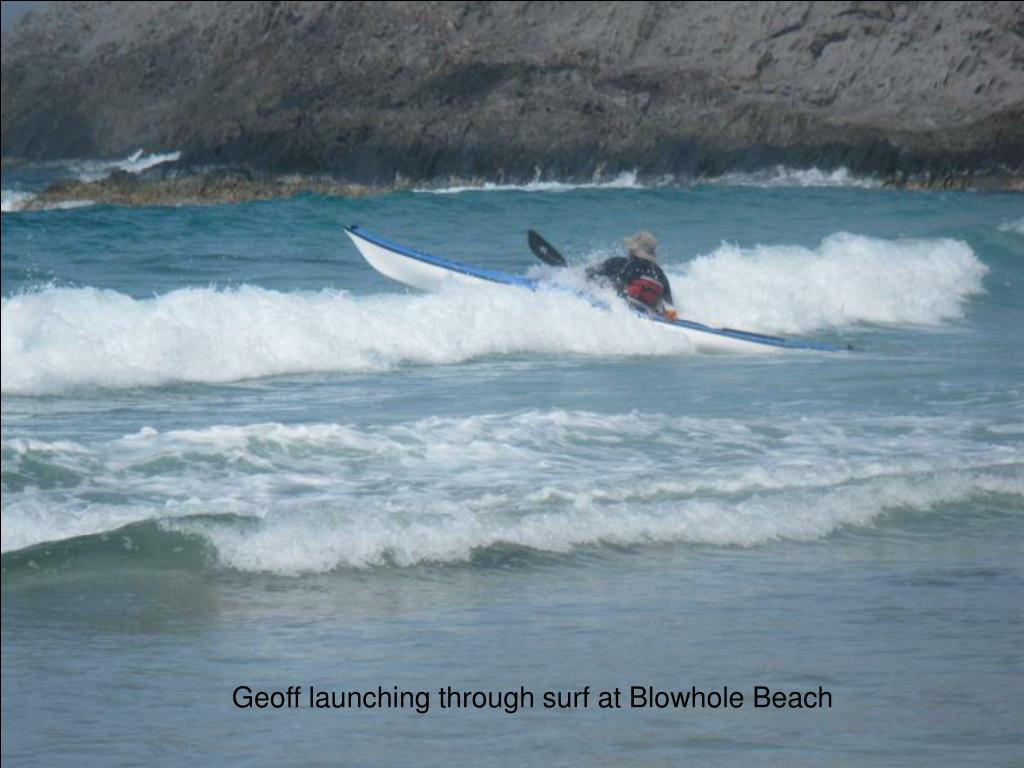 Geoff launching through surf at Blowhole Beach