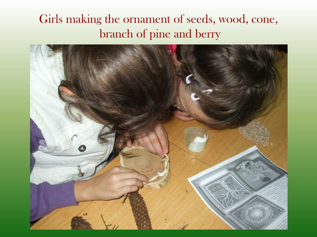 Girls making the ornament of seeds, wood, cone,
