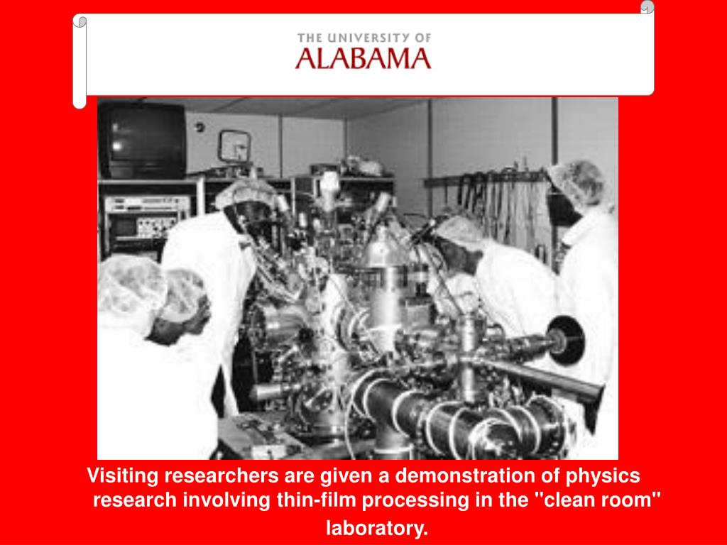 """Visiting researchers are given a demonstration of physics research involving thin-film processing in the """"clean room"""" laboratory."""
