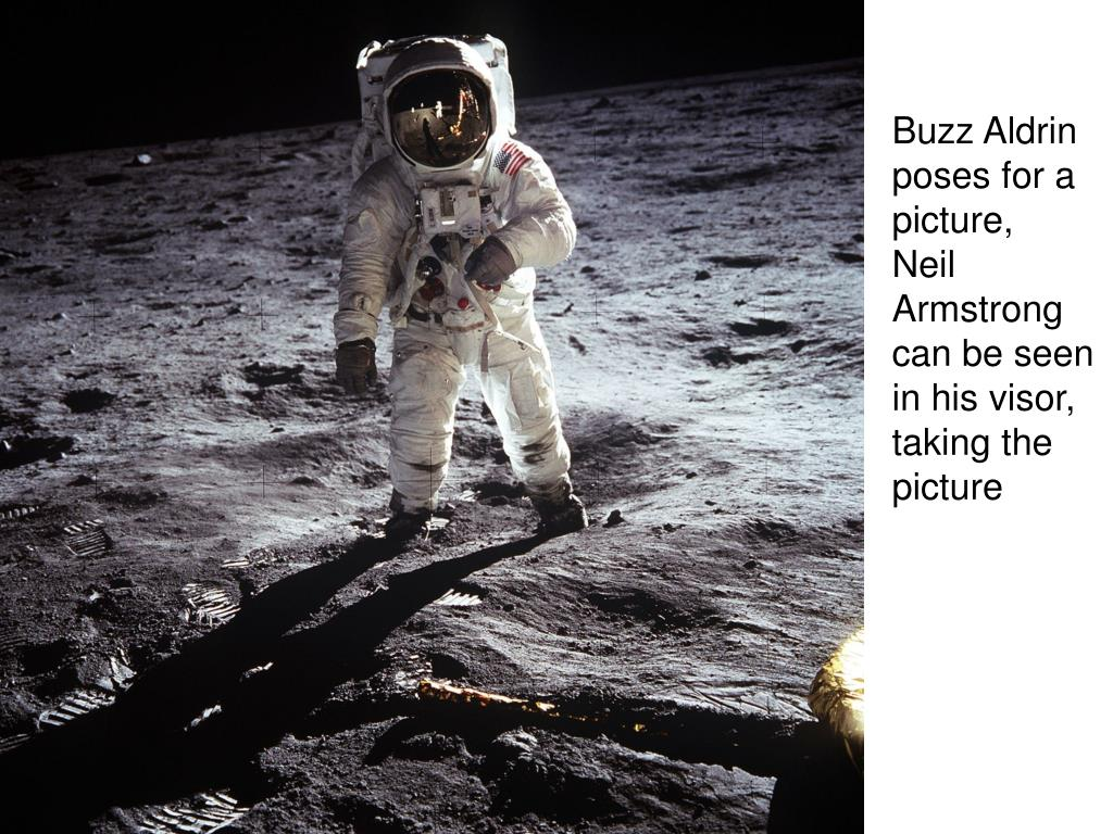 Buzz Aldrin poses for a picture,    Neil Armstrong can be seen in his visor, taking the picture